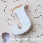 Letter J wood jigsaw puzzle piece