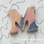 Letter M wood jigsaw puzzle piece