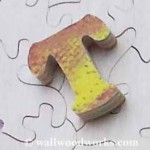 Letter T wood jigsaw puzzle piece